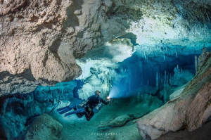 Cave diving in cenote Nariz, Mexico by Cyril Buchet